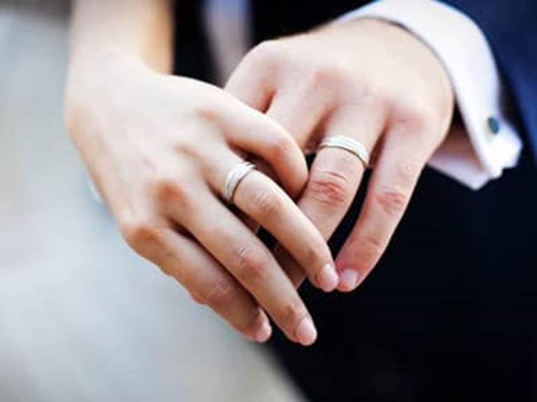 married couple, wedding rings